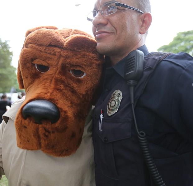 National Night Out // People across the city came together with police officers and emergency medical personnel at block parties, cookouts and other neighborhood activities. Below, Richmond Police Officer Juan Tejeda hugs McGruff the Crime Dog, who was a hit with youngsters at the North Side event.