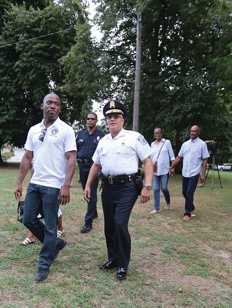National Night Out //  Richmond Police Chief Alfred Durham, right, and Mayor Levar M. Stoney arrive at Pollard Park in North Side on Tuesday evening for National Night Out, the effort to unify law enforcement and residents in communities across the nation.