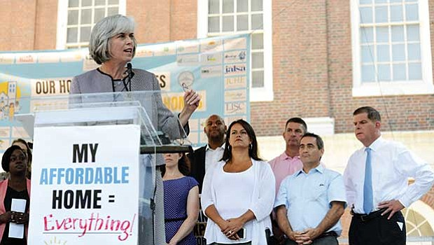 U.S. Rep. Katherine Clark speaks during a rally at Faneuil Hall as local elected officials look on.