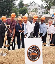 Nuestra Comunidad CDC Executive Director David Price (center) leads the ceremonial groundbreaking for the Bartlett Station project.