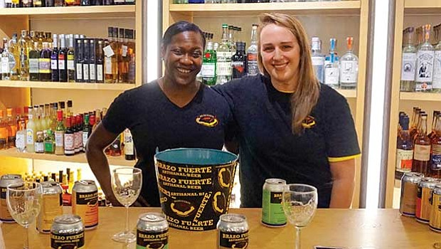 Brazo Fuerte Artisanal Beer Founder and CEO Bev Armstrong (l) with Director of Operations Raylen Dziengelewski at a beer tasting at Cambridge Spirits in Kendall Square, Cambridge.
