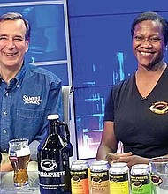 Bev Armstrong, founder of Brazo Fuerte Artisanal Beer, with Jim Koch, founder of Boston Beer Co., in an NECN interview about the 2017 Samuel Adams Beer and Business Experienceship awarded to Armstrong.