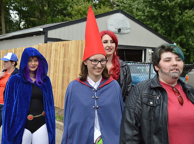 Teens wait in line to show of their costumes for the judges of the cosplay contest at Comicopolis in Lockport.