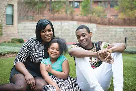 Shyronn Jones, 39, and her children, Shyloh, 5, and Shymere, 14, live in Atlanta. The federal program called Housing Opportunities for Persons With AIDS helps Jones afford an apartment near a park where her daughter can safely play. (Photo by Trevor Cochlin/Courtesy of the Jones family)