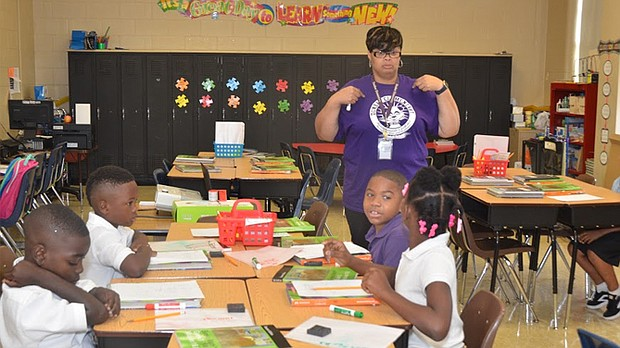 "At Dunbar Elementary School on Monday, teachers and students began the learning process for 2017-18, a school year that would not have been without ""a groundswell of community support."" 