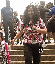 With many holding hands as they entered the building, students and parents stepped into the future of Dunbar Elementary School.