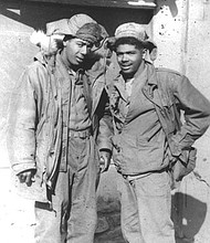 Louis S. Diggs, (right) a member of the 726th truck company with his brother George A. Diggs, a member of the 24th Infantry Regiment. They spent Christmas of 1951 together in Korea.
