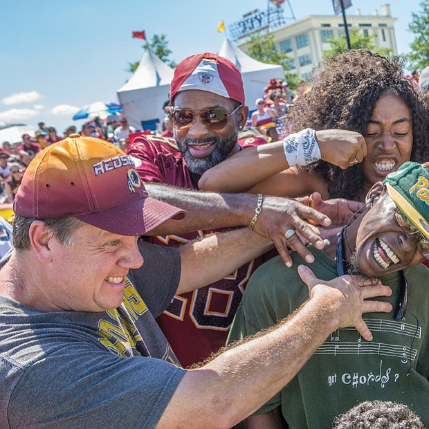 Fans of all ages turned out for the event that included a good-natured drubbing of a Green Bay Packers fan who was dressed showing his allegiance.
