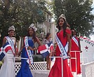 Anairis Santana, Cristal Santana, Someidy Francisco and Jerika Arendell ride on queens float.