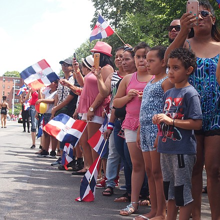 Spectators line the parade route as it passes Mozart Park.