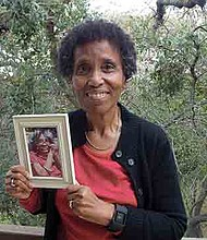 Andrea Gourdine holds a photo of her mother, Gladys Brown, who died in 2012 after being diagnosed with Alzheimer's. Brown donated her brain to the University of California-Davis, for research. (Anna Gorman/KHN)