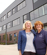 Faubion School Principal Jen McCalley and Concordia Dean of Education Sheryl Reinisch get ready to open the doors to a brand new landmark school. The northeast Portland school was rebuilt from the ground up as part of a community based partnership with Concordia University to usher the city's education system into the 21st Century.