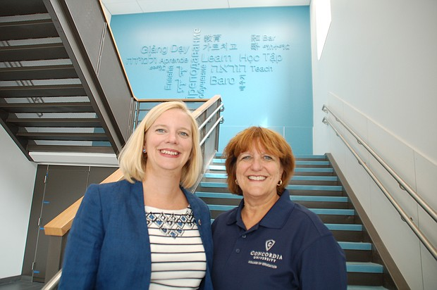 Faubion School Principal Jen McCalley and Concordia Dean of Education Sheryl Reinisch share one of the many spaces inside the new school which fosters and celebrates diversity and community.