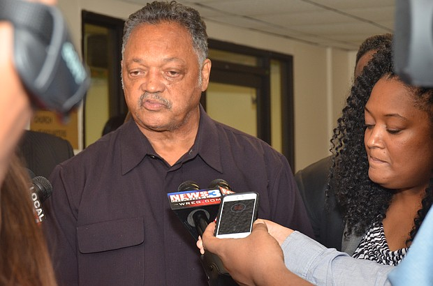Rev. Jesse Jackson addresses media after meeting with CME leaders and City of Memphis officials, including Joann Massey, Director of the Office of Business Diversity Compliance (right).