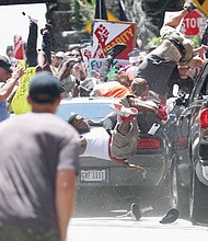 A car struck another vehicle near a crowd of antiracist protesters, killing a 32-year-old woman, Heather D. Heyer in Charlottesville, Virginia.