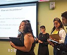 Iris Lizbeth Aguilar, Katherine Maldonado, Karolyn Jimenez and Nestor Fajardo present a business idea at Babson College.