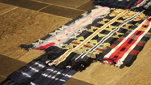 Artist Stephen Hamilton's 30-foot installation in the lobby of 290 Congress St. blends together textiles made with traditional West African techniques.