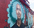 "Entrepreneur Alex Castillo's likeness adorns a wall in Roslindale as part of the City of Boston's art initiative, ""To Immigrants With Love."""