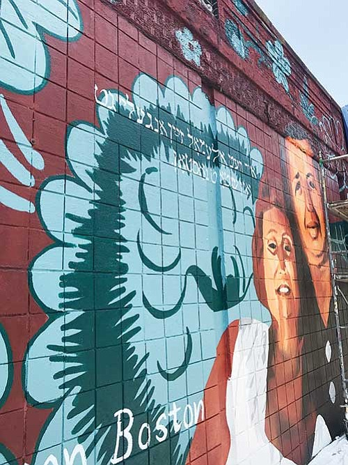 "Boston's ""To Immigrants With Love"" art initiative has reproduced images of local immigrants in murals in Roslindale and East Boston."