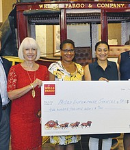 Micro Enterprise Services of Oregon (MESO), a community development financial institution working with disadvantaged communities, receives $200,000 from Wells Fargo to provide loans to entrepreneurs who might not qualify for a business loan from traditional sources. Pictured from left to right are Wells Fargo executive Andrew Tweedie, Tracie Curtis, MESO Deputy Director Tastonga Davis, MESO Executive Director Nita Shaw and Wells Fargo Executive Cobi Lewis.