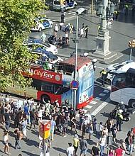 A van has hit a crowd at Placa Catalonia, in the Ramblas area of Barcelona