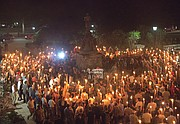 "White nationalists march with torches in a Nazi-style parade Friday night on the University of Virginia campus. The torch-lit event took place on the eve of the larger ""Unite the Right"" rally in the city of Charlottesville protesting the planned removal of a statue of Confederate Gen. Robert E. Lee."