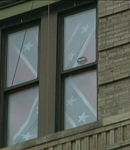Confederate flag in window in East Village