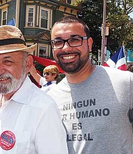 Suffolk County Register of Deeds Felix D. Arroyo and Ricardo Arroyo march in the parade.