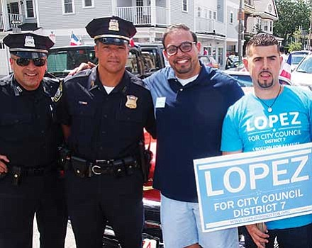 Officer Carlos Martinez, Detective Richard Medina, City Council candidate Jose Lopez, Nigel Rossello-Cornier and Lt. Detective Luis Cruz.