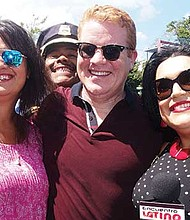 At-large City Councilor Anissa Essaibi-George, Police Chief William Gross (photobombing in rear), and Centro host Yadires Nova-Salcedo enjoy a moment during the parade.