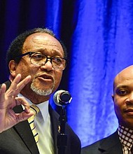 Dr. Benjamin F. Chavis Jr. (left), the president and CEO of the NNPA, talks about bridging the racial wealth gap during panel discussion hosted by the New York Life insurance company as Rev. Delman Coates, the senior pastor of Mt. Ennon Baptist Church looks on.