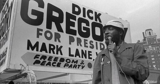 American comedian and activist Dick Gregory campaigns for president with the Freedom Peace Party in New York, 1969.