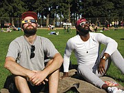 Mother Nature cooperates with clear skies for the Great Solar Eclipse, drawing Andrew Fox of Portland (left) and Jewan Manuel of Michigan to Peninsula Park in north Portland where the view of the moon obscuring the sun reached nearly 99 percent complete, lowering light levels dramatically.