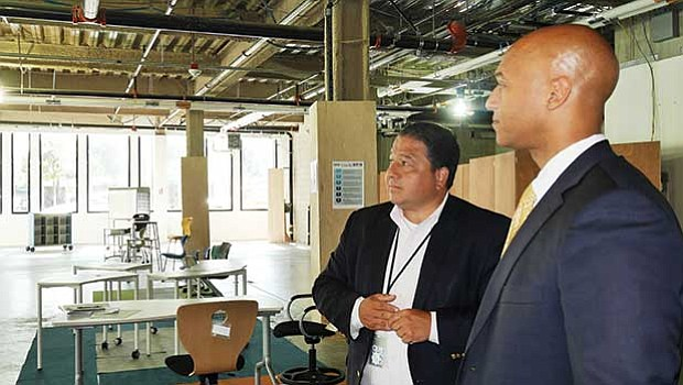 John Barros, the city of Boston's chief of economic development, and BPS Chief of Staff Rob Consalvo in the vacant 7,800-square-foot space at the front of the Bolling Building. With a new request for proposals, the city hopes to find a viable restaurant tenant for the site.