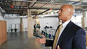 John Barros shows the vacant 7,800-square-foot space at the front of the Bolling Building and discusses the city's and the community's desire to see a full-service restaurant there.