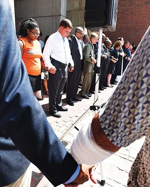Elected officials and clergy join together in a prayer service on Boston City Hall Plaza prior to the Free Speech Rally held last Saturday.