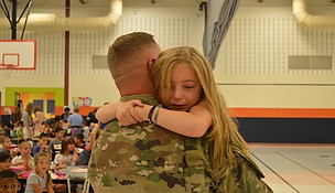 Vincenza Campbell is overcome with tears after being reunited with her father, Army Sergeant Brian Campbell, who surprised the 2nd grader at Thomas Jefferson Elementary in Joliet this week. (photo by Brock A. Stein)