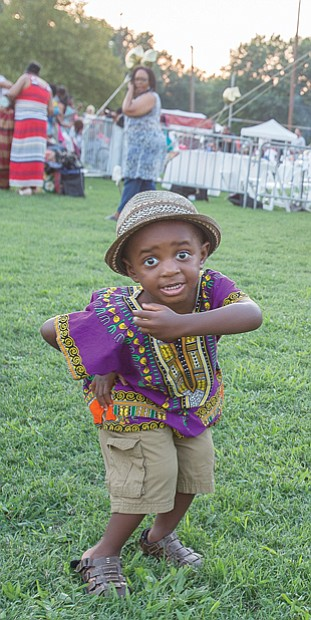 Down home groove // Cairo Kelly, 2, dances to the music at the Down Home Family Reunion last Saturday at Abner Clay Park in Jackson Ward. This was the 27th year for the annual festival that seeks to demonstrate how African heritage has influenced the American South by sharing experiences and traditions through food, storytelling, music, art and a marketplace. Please see more photos on B2.