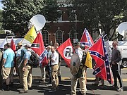 "Alt-right members preparing to enter Emancipation Park holding Nazi, Confederate, and Gadsden ""Don't Tread on Me"" flags. - Wikipedia photo"