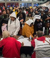 Thousands jam the George R. Brown Convention Center in Houston seeking shelter from the massive flooding and destruction in southeast Texas from Hurricane Harvey which became the heaviest tropical downpour in U.S. history Tuesday. (AP photo)