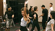 "Ashley LaLonde and the cast of ""Burn All Night"" warm up before rehearsal."