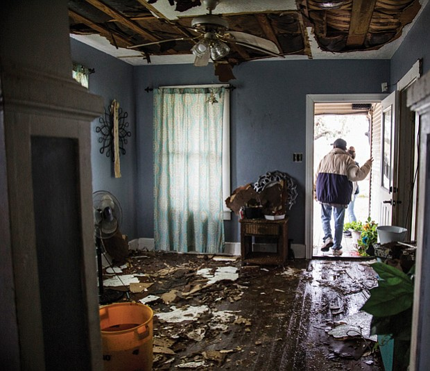 Lucas Garcia walks out of his home Saturday in Refugio, Texas, where he and other family members rode out Hurricane Harvey in one room.