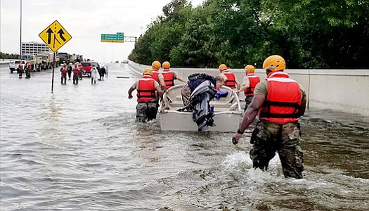 Soldiers with the Texas Army National Guard move through flooded Houston streets as floodwaters from Hurricane Harvey continue to rise, Monday, August 28, 2017. More than 12,000 members of the Texas National Guard have been called out to support local authorities in response to the storm. (1st Lt. Zachary West/ U.S. Army/Wikimedia Commons)