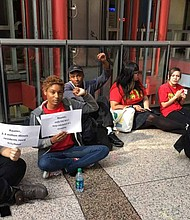 "In the recent wake of Governor Bruce Rauner's veto of an $15 minimum wage hike, several workers gathered on the floor of the James R. Thompson Center lobby chanting, ""Rauner Vetoed $15, Veto Rauner in 18!"" Photo Courtesy of Fight for $15"
