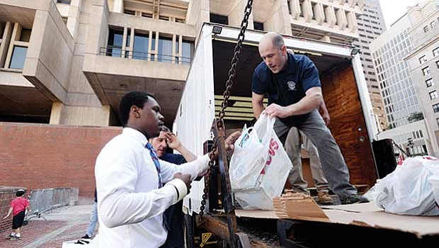 Volunteers at Boston City Hall sort and pack donated items to be transported down to flood victims in Houston, Texas and the surrounding areas that were devastated by Hurricane Harvey.