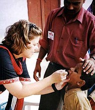 African American children are at a great risk of contracting infectious diseases like measles, due to not receiving full doses of vaccines recommended by the Centers for Disease Control and Prevention (CDC). Photo Credit: Centers for Disease Control and Prevention
