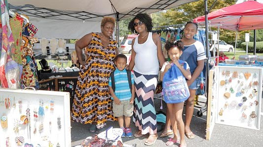 Felicia Mosley with her children ages 12, 6 and 3 visited the Sweet Pea Accessories with owner, Pamela Roberts.