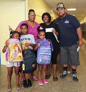 Val Smith, Ebony David and children (Lawnside Students) are pictured with Brother LaMar Bell of Hiram Lodge #5 F & AM, PHA Lawnside, NJ. Brothe LaMar Bell gave Ebony's son a $10 Hair Cut Voucher sponsored by the Hiram Lodge #5 F & AM, PHA Lawnside, NJ.