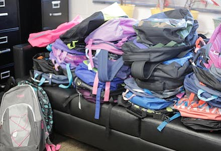 Backpacks filled with school supplies donated by a local church.