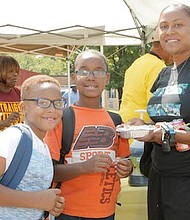 Parent, Sharee Huff with sons, Shane and Zachary Huff taking part of the food vendor, Nellie's Place.